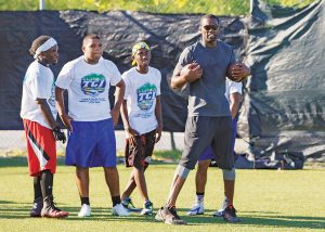 Moss connects with youth through the game of football, but his bigger hope is that the lessons they learn will help them to realize their own personal goals.
