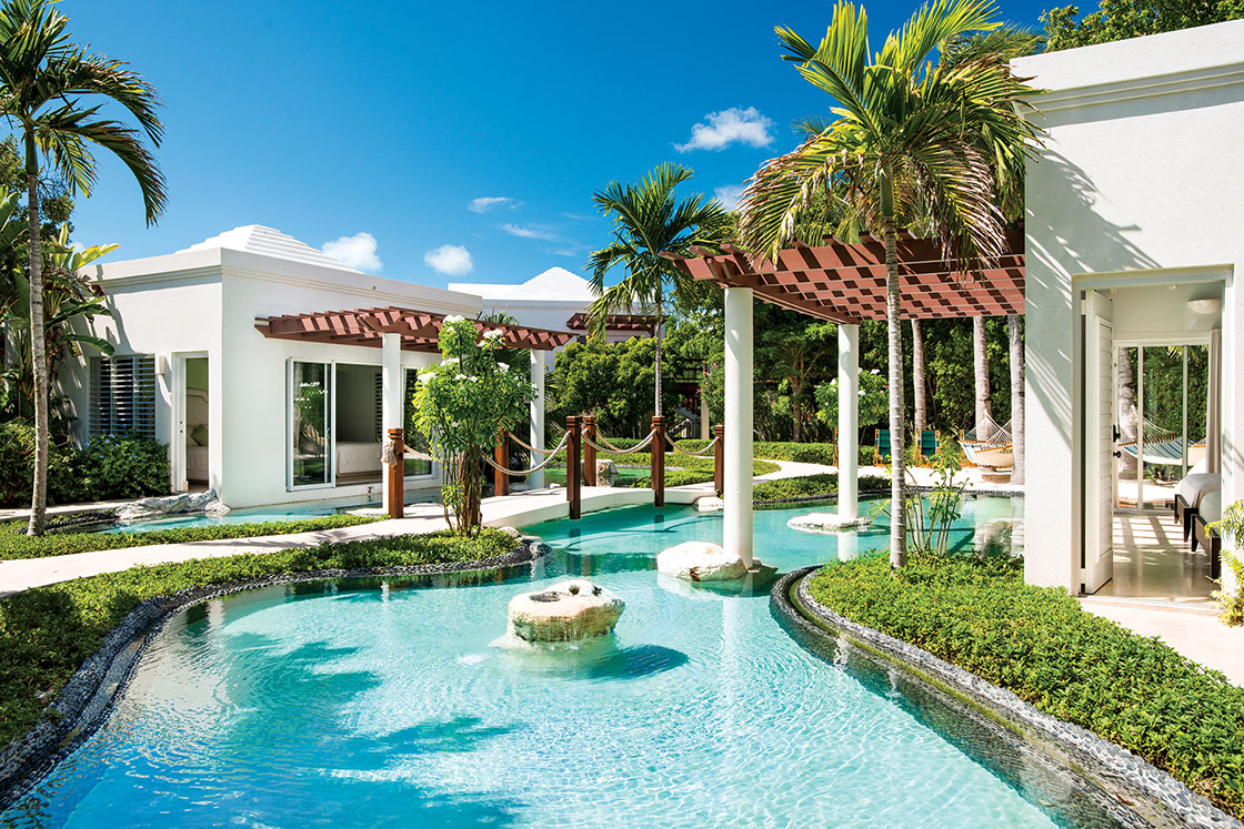 Reflecting pools cascade into multiple waterfalls and lagoons throughout the property.